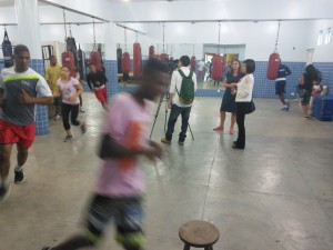 Kids warming up for boxing training, with a Taiwanese TV crew filming in their midst!