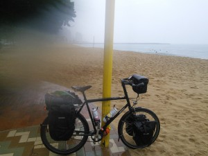 Leg over surveying the beach in torrential rain